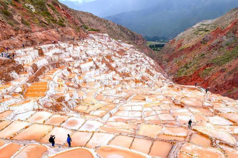 Maras, Moray are two prime places located remotely in the Sacred Valley of Incas. Both sites had a unique importance and distinct use during the Incan civilisation. Maras is known for its salt pans those are nestled on the slope of a hill side. These salt pans have been in use since pre Inca times. The locals here have been practising the salt farming techniques just as it was during the olden days. There is no mechanism and it is completely manual. The farmers here let the natural spring water flow into these geometric shaped puddles. When the water evaporates, it leaves behind crystallised salt. The salt farmers then scrape out the salt. Salt of Maras is pinkish in colour and is highly nutritious and had a distinct taste. Moray, on the contrary has been a prime agricultural source for Incas. The site has a circular shaped agricultural terrace that resembles a bit of Roman amphitheatre. To Incas this was more like and agricultural research laboratory. These circular terraces have varied temperatures at each level, which made Incas to learn the growth conditions of crops at different climatic conditions. We at Treks in Cusco, offer a daily half day tour to Maras Moray from Cusco.